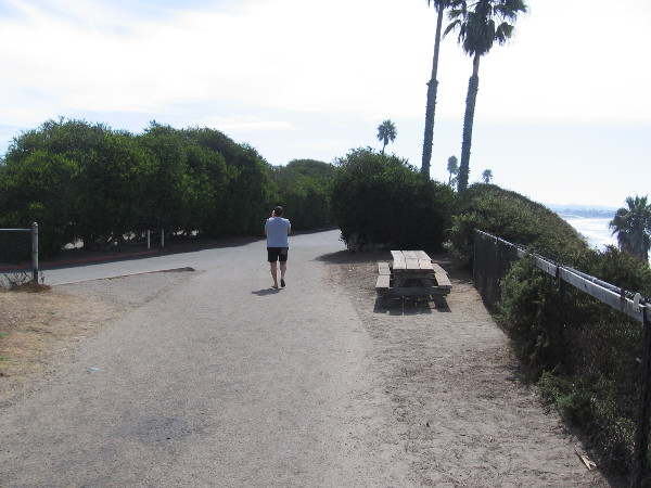 Walking down a path that enters the campground area at San Elijo State Beach.