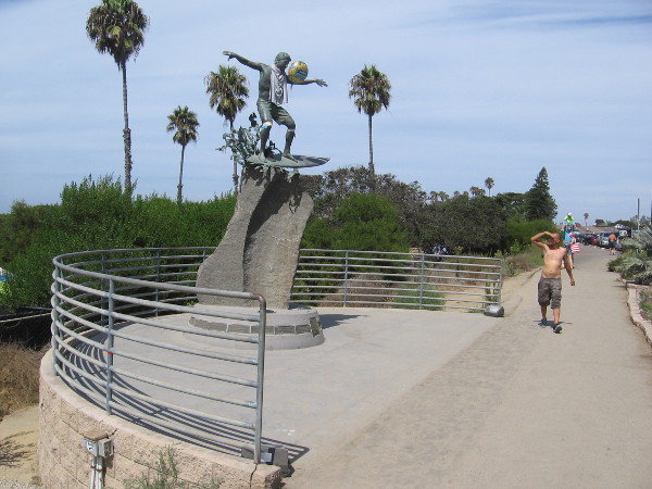 Someone looks up at the Cardiff Kook, which is often dressed up by pranksters in odd clothing and costumes.