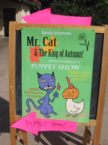 Mr. Cat and The King of Autumn is showing at the Marie Hitchcock Puppet Theatre. That's the goofiest looking chicken I ever saw.