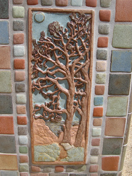 Some sculptural Torrey Pine artwork on the side of the monument.