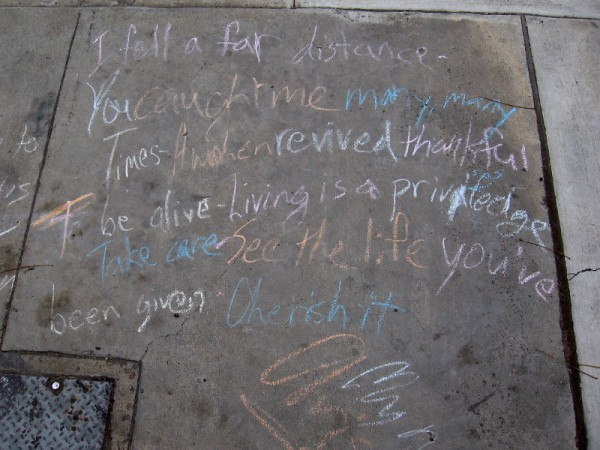 Grateful words. A chalk poem on a sidewalk.