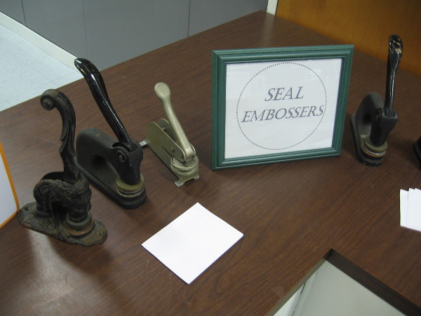 A collection of old City Clerk seal embossers.