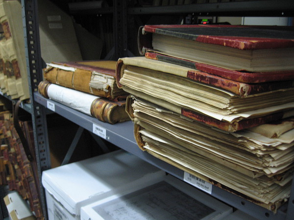 Old books contain important records in the cold vault of the San Diego City Clerk's Archives Center.