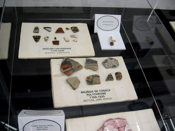 The exhibit includes fragments of bottles, jars, bowls and plates from early San Diego.