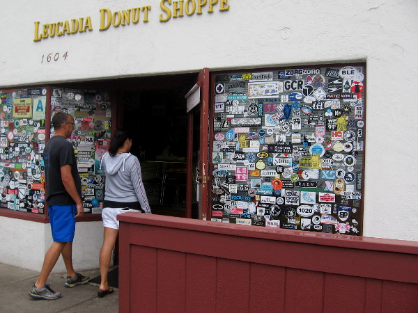 There are so many stickers on the Leucadia Donut Shoppe windows, I won't be tempted by what can't be seen inside.