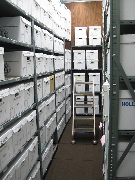 Stacks of special boxes containing official records fill the temperature and humidity controlled cold vault at the City Archives.