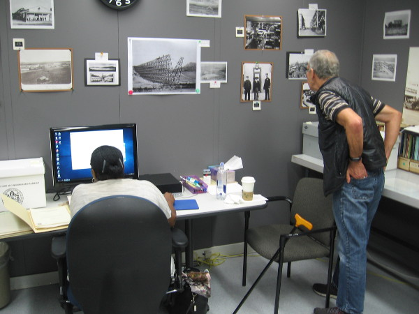 In one room at the Archives Center, old photographs are scanned and categorized in order to be digitized for easy public access.