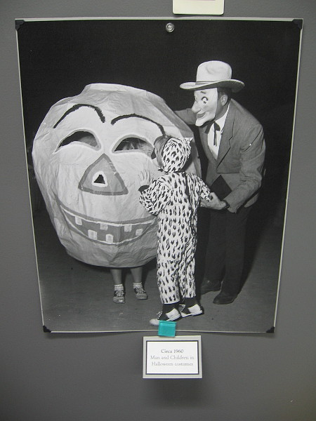Man and Children in Halloween costumes, circa 1960.