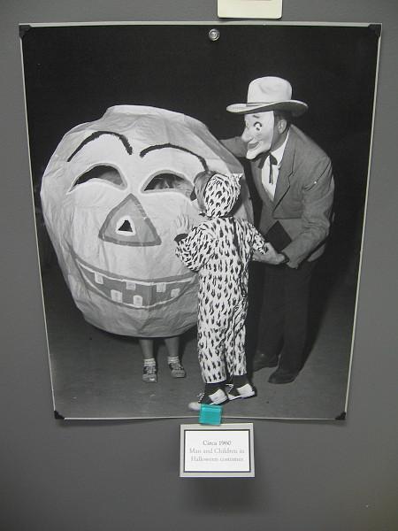 Man and Children in Halloween costumes, circa 1960.