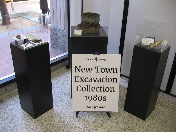Artifacts on display include the New Town Excavation Collection from the 1980s.