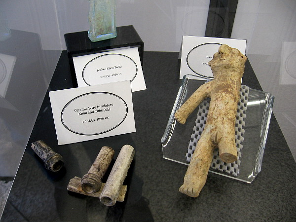 Other early artifacts from New Town include a broken bottle, ceramic wire insulators and a clay effigy.