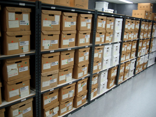 Boxes upon boxes hold tons of paper records in the basement of City Hall!