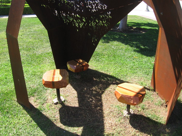 Three can sit near each other in this shady sculpture and share an experience.