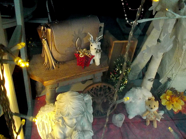 Beautiful holiday gifts are beginning to appear in some downtown shop windows.