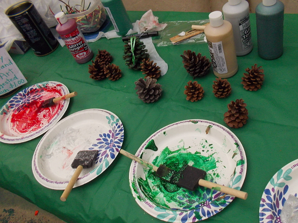 Painting pine cones in Christmas colors!