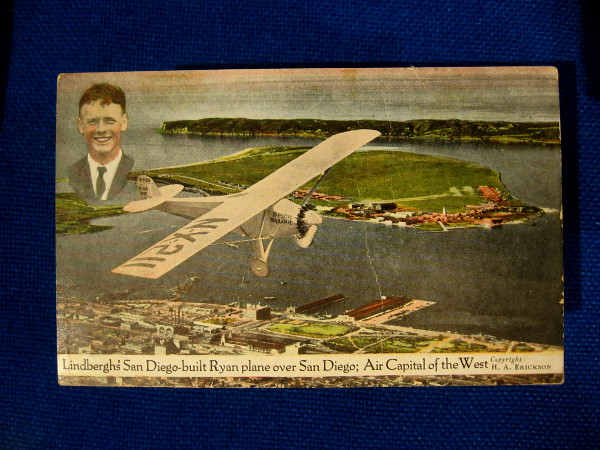 Vintage postcard shows Lindbergh's San Diego-built Ryan plane over San Diego; Air Capital of the West.