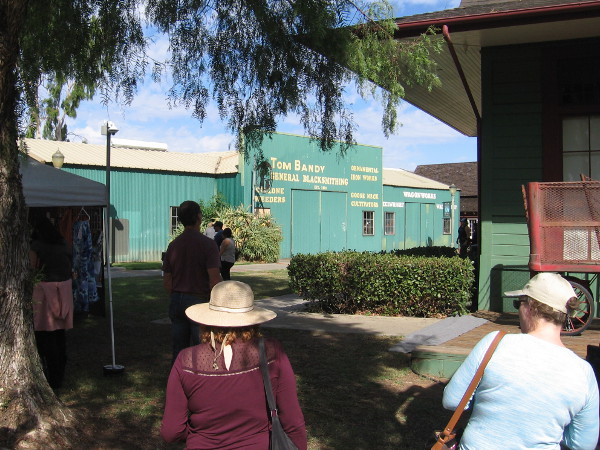 People in Grape Day Park head toward buildings that are part of the Escondido History Center's Heritage Walk.