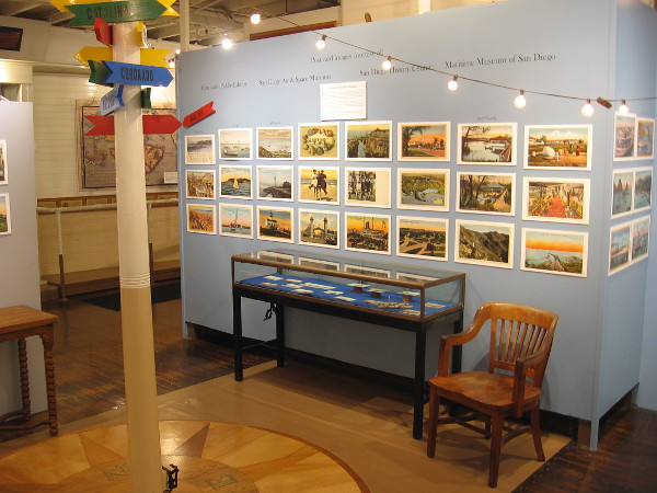Many historical postcards are on display for the Wishing You Were Here exhibit at the Maritime Museum of San Diego.