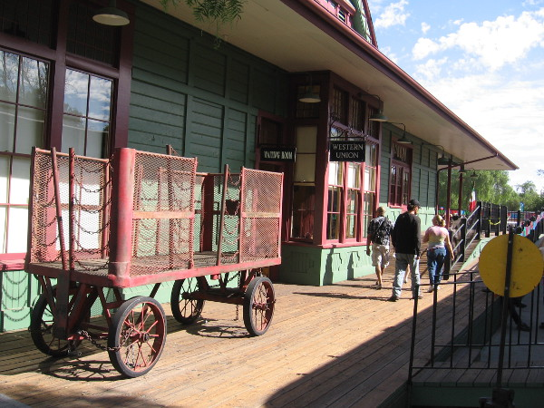 The platform side of the historic train depot, complete with Western Union sign and vintage luggage cart.