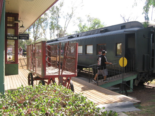 Parked next to the depot's passenger platform is railroad car number 92, built by the Pullman Company in the 1920s.