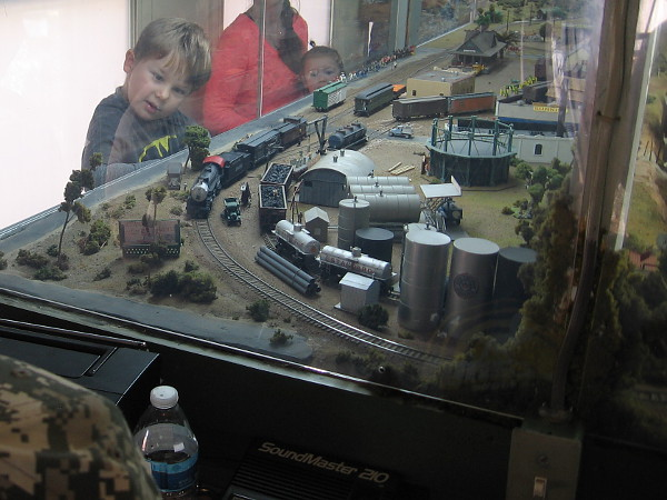 Inside the railroad car is a huge model train layout that kids love!