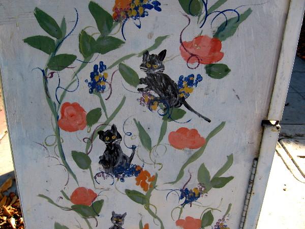 Cats hidden in flowers.