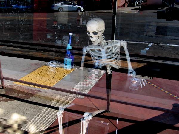 Skeleton drinking.