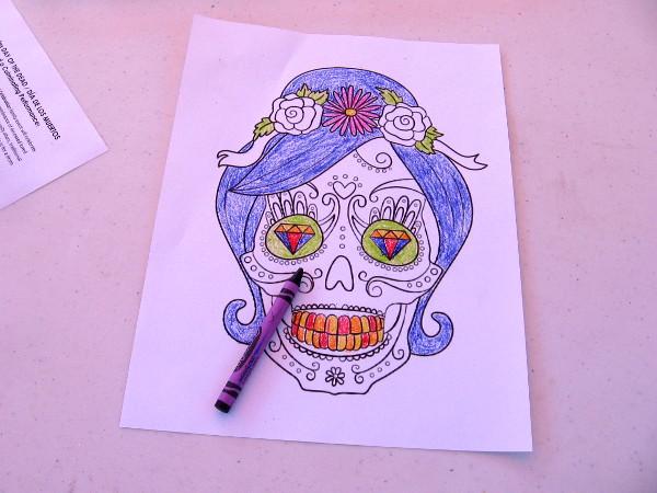 Día de Los Muertos crayon art produced by someone during the Old Globe's festival.