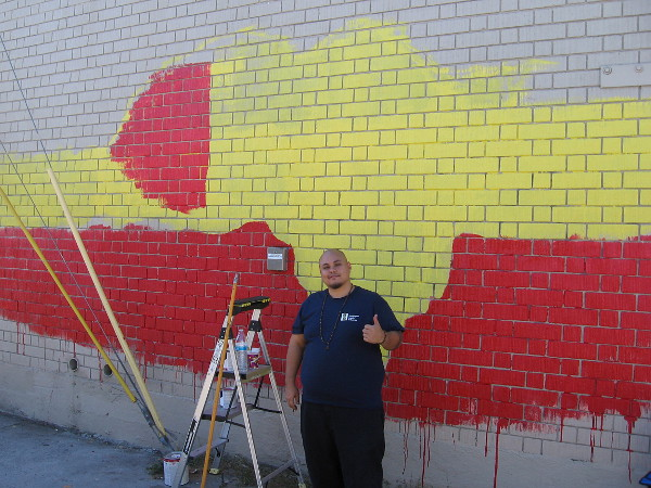 GMONIK @gmonikart has begun a new mural in the alley by 7-Eleven. It will depict Africa and the message One Love.