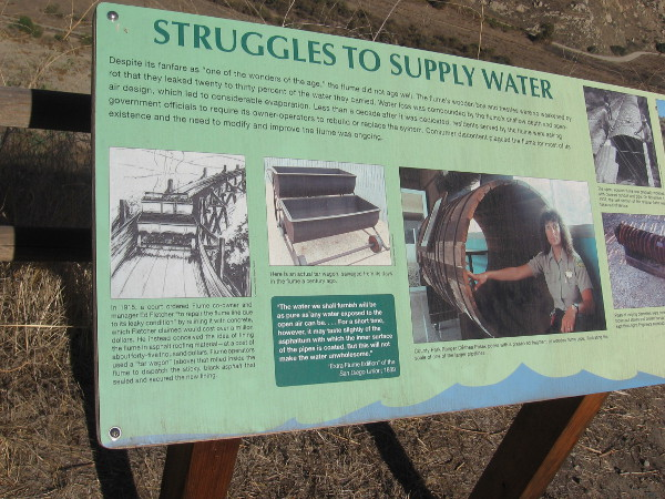 Sign describes the struggles to supply water. The open flume had troubles with massive leakage due to rot, and evaporation.