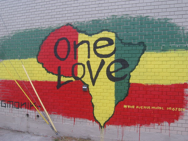 One Love mural in City Heights by artist GMONIK.