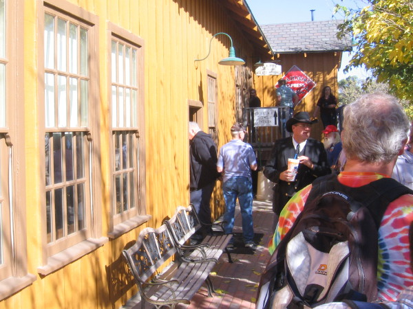 Visitors wait in line at the old Campo depot to pick up tickets for a train ride during the centennial event.