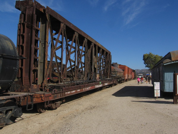 On top of one flatcar is a huge turntable that was used for turning railroad locomotives and cars.