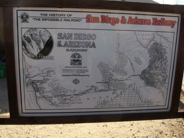 A sign maps the route of the San Diego and Arizona Railway from San Diego through Mexico to El Centro.