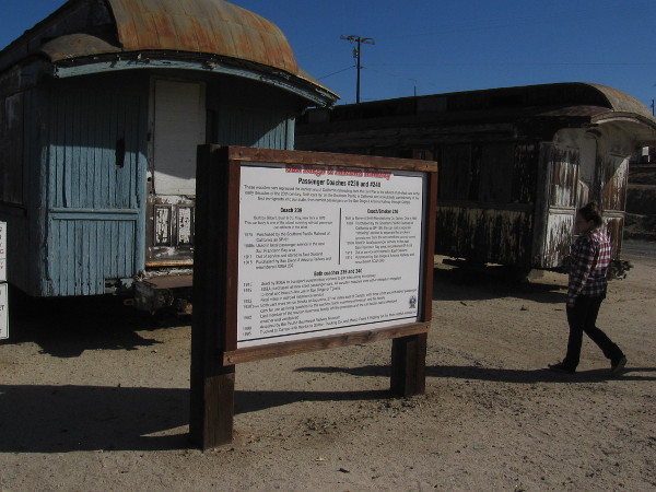 A sign describes two wooden passenger coaches built in the late 19th century. Coach 239 is one of the oldest surviving railroad passenger car artifacts in the West.