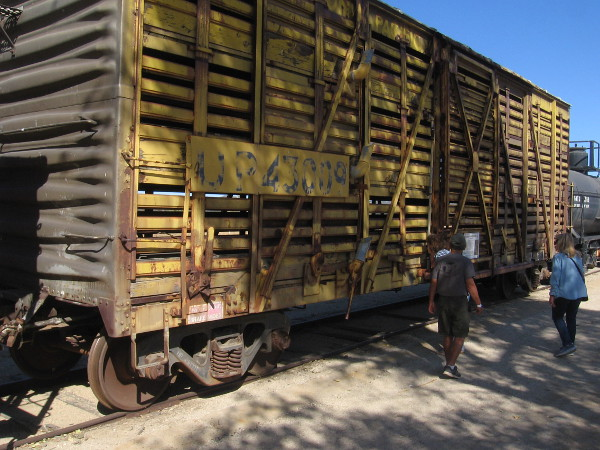 Visitors check out an enormous old freight car.