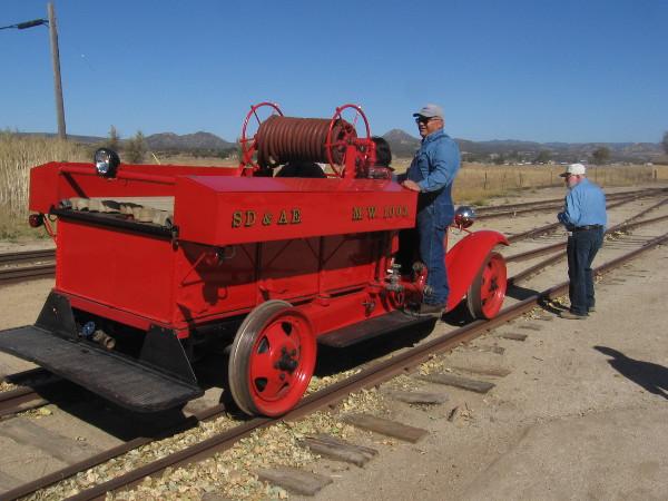 Here comes the San Diego & Arizona Eastern MW 1003 1931 Ford Model AA Rail Fire Engine.