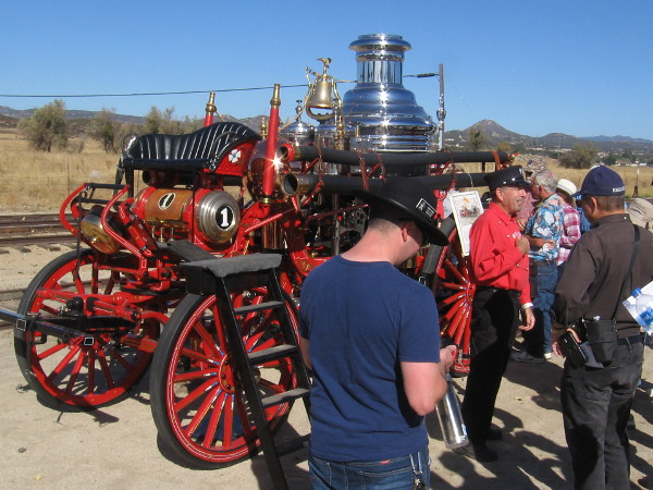 Visitors to the event check out a working 1902 American steam fire engine.