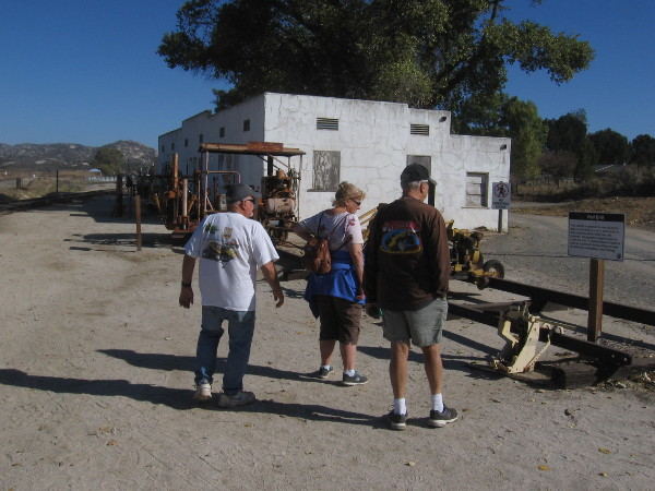 People check out some of the railroad equipment on display on the museum grounds.