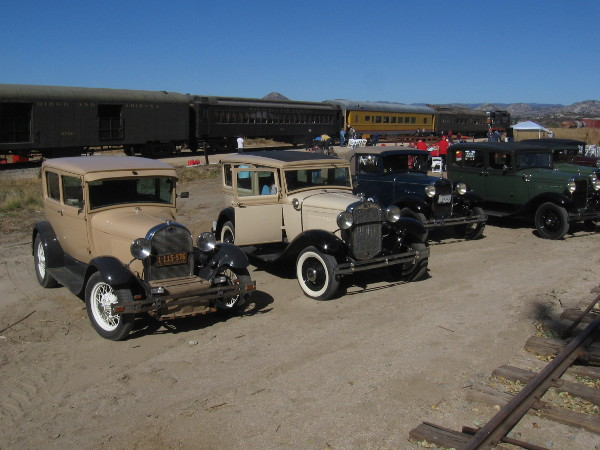 Vintage automobiles and vintage trains!