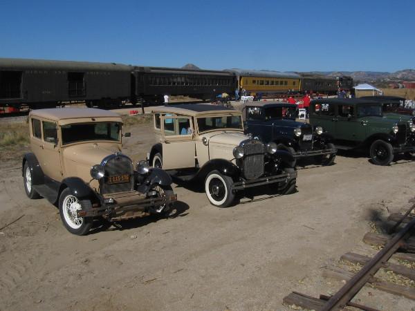Vintage automobiles and vintage trains!