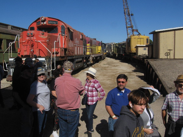People were lined up for lunch near some of the Pacific Southwest Railway Museum's many outdoor railroad cars.