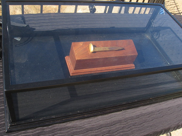During the centennial ceremony, the original gold spike from 100 years ago was on display in a glass case nearby.