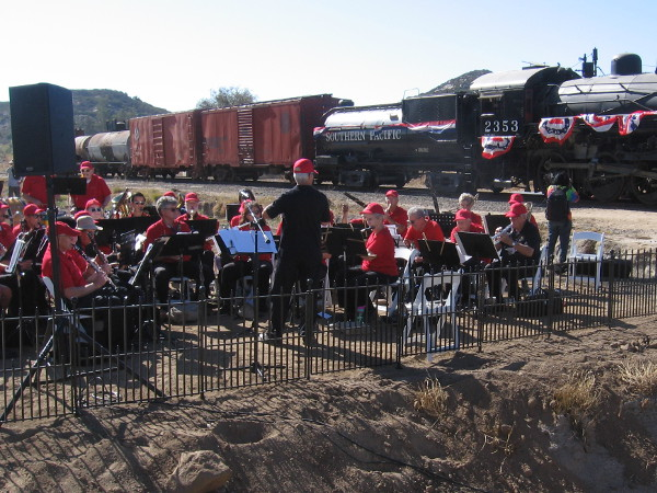 The San Diego City Guard Band plays the San Diego Progress March, written for the railway's completion 100 years ago and performed then by the 1919 version of the City Guard Band.