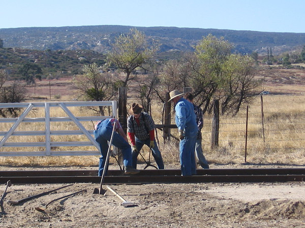 Reenactment of workers completing a transcontinental railroad route.