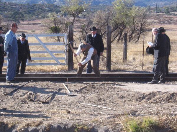 John D. Spreckels, creator of the San Diego and Arizona Railway, hammers the final spike.