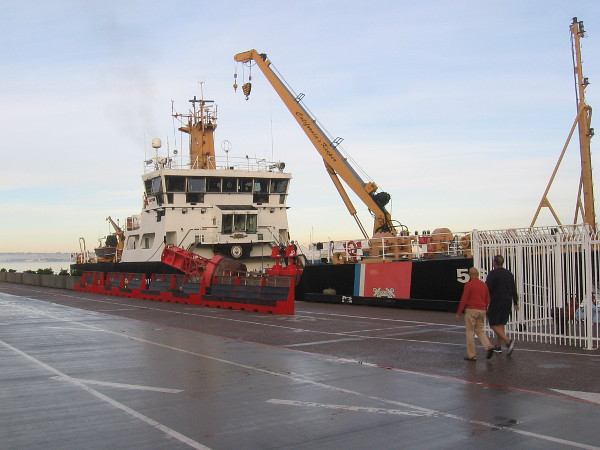 A United States Coast Guard buoy tender is docked at Broadway Pier.