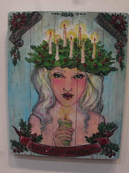 Christmas Ale, by artist Tara Alvarado. Acrylic on wood. A beer label inspired by The Spirit of Christmas Past from A Christmas Carol.
