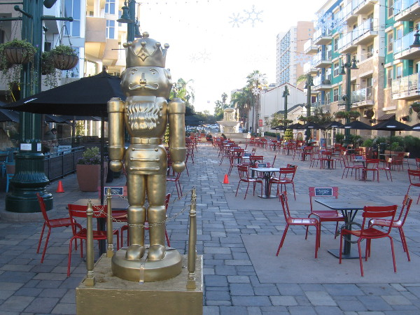 Golden nutcracker stands guard at west end of Piazza della Famiglia in Little Italy one early morning in December.