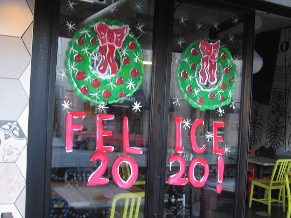 Felice 2020! painted on a restaurant window.
